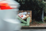 Sofa and teddy bear placed on the street for collection