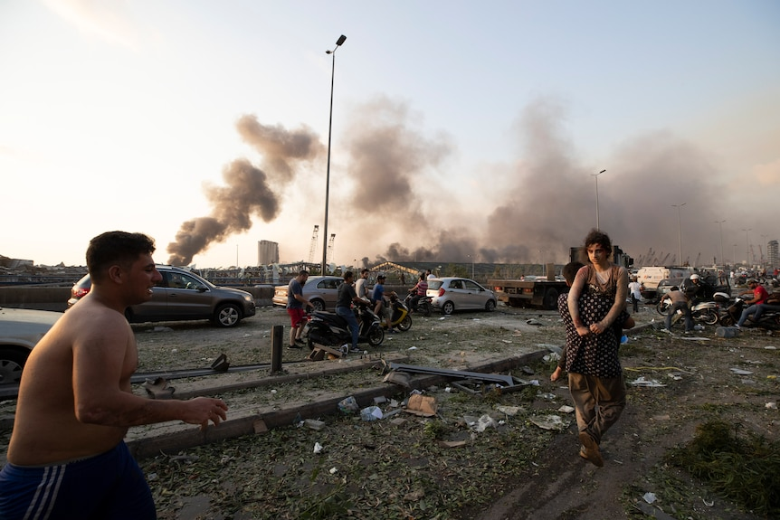 People evacuate wounded after of a massive explosion in Beirut, Lebanon