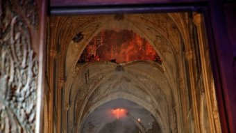 Flames and smoke billow out as stone vaults are seen saving cathedral from total destruction.