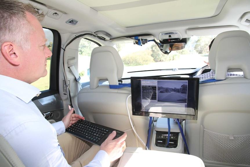 Volvo Australia's technical manager David Pickett in a car.