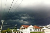 Storm clouds roll in over the Brisbane suburb of Annerley on October 15, 2011.