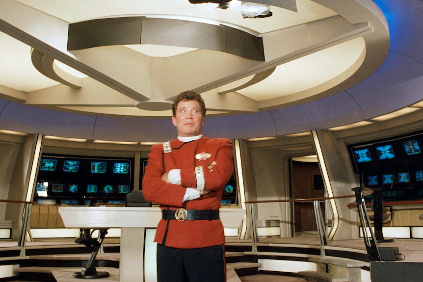 This 1988 file photo shows a young William Shatner in his Star Trek Captain Kirk costume aboard the Starship Enterprise
