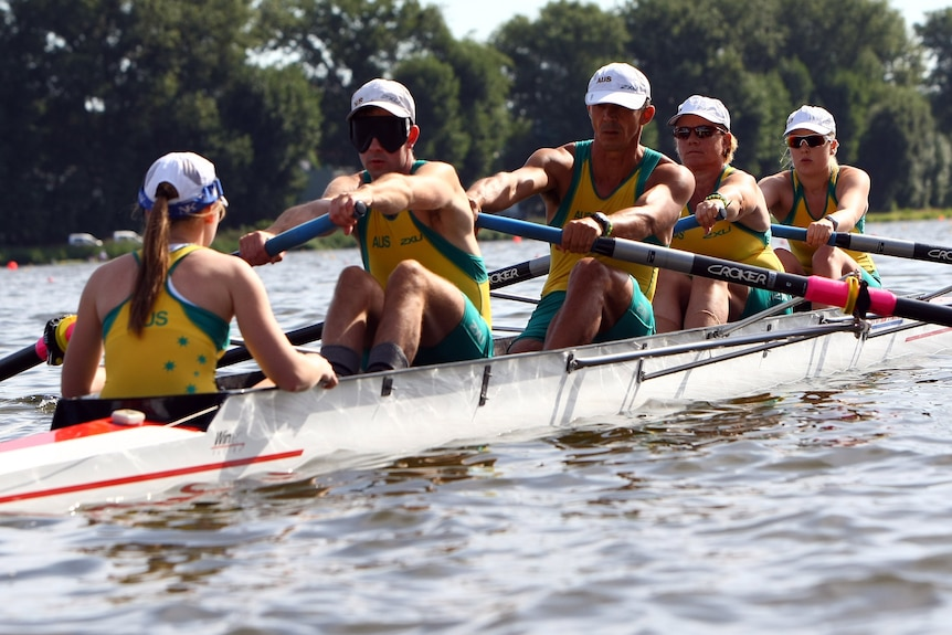 Four rowing competing in an event
