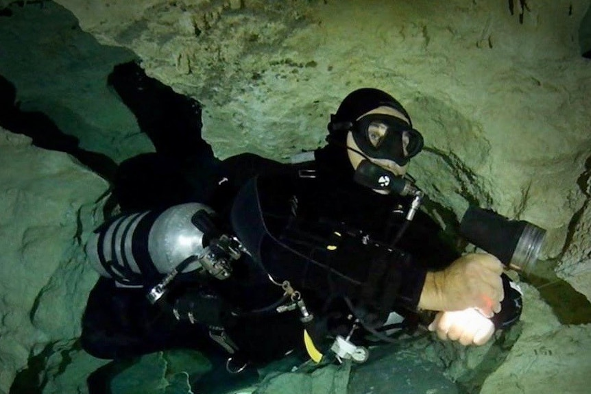 Joseph Bicanic is pictured underwater in a cave.