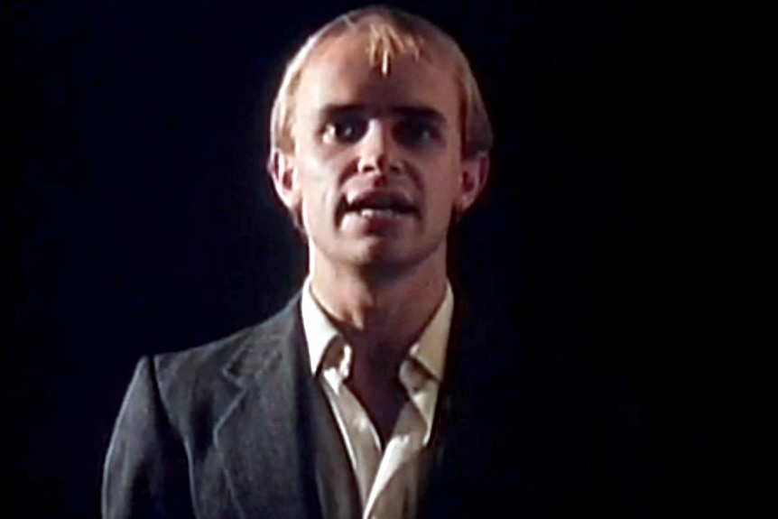 Greg Ham in the Who Can It Be Now video.