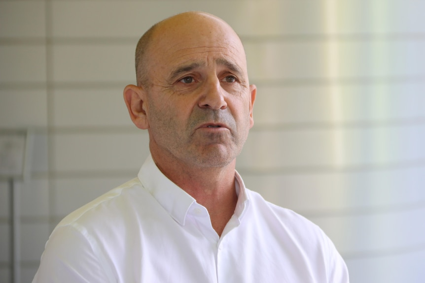 A head and shoulders shot of WAIS chief executive Steven Lawrence speaking during a media conference wearing a white shirt.