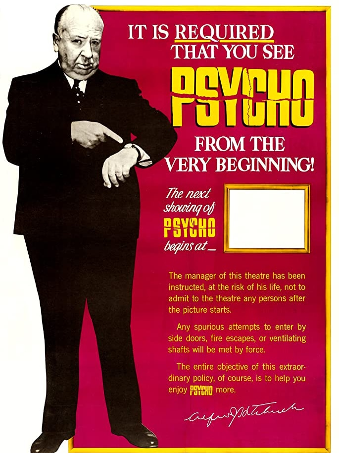 The poster shows Alfred Hitchcock, in a suit, pointing to his wristwatch