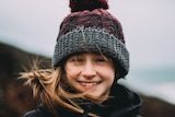 Girl in beanie being blasted by wind