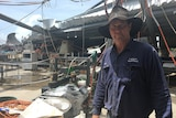 Carl Walker in his packing shed, which was ripped apart in the cyclone.