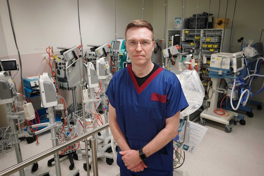 Stephen Warrillow standing among medical equipment in the Intensive Care Unit