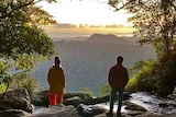 View from rear of two people standing at a lookout.
