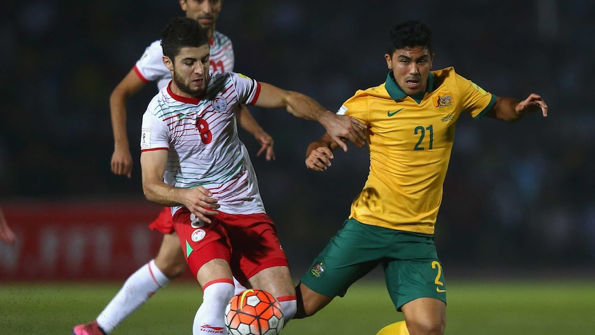 Massimo Luongo is robbed of possession by Nuridden Davronov