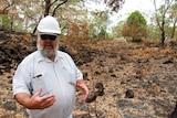Gunditjmara elder Denis Rose stands in a burnt clearing at Budj Bim.