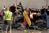 Emergency services at the scene where a car was crushed under a cement wall in Quapaw, Oklahoma.
