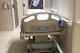Empty bed in Hobart hospital corridor