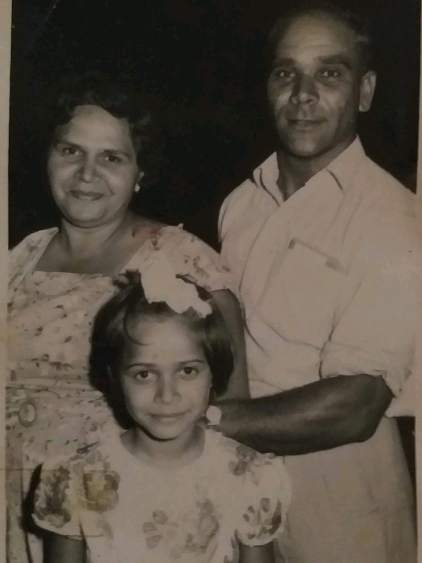 An old photo about an aboriginal family of three