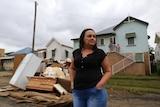 Joanne Hourigan from Casino Street South Lismoresurveys the damage on her street on April 2