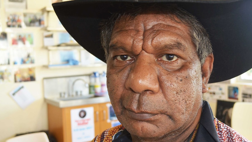 A close up shot of Indigenous elder Charlie Chambers wearing a black cowboy hat  at Southern Queensland Correctional Centre.