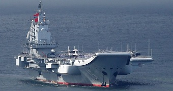 An aircraft carrier at sea.