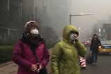Smog over Beijing, China, people wear masks, as air pollution takes over