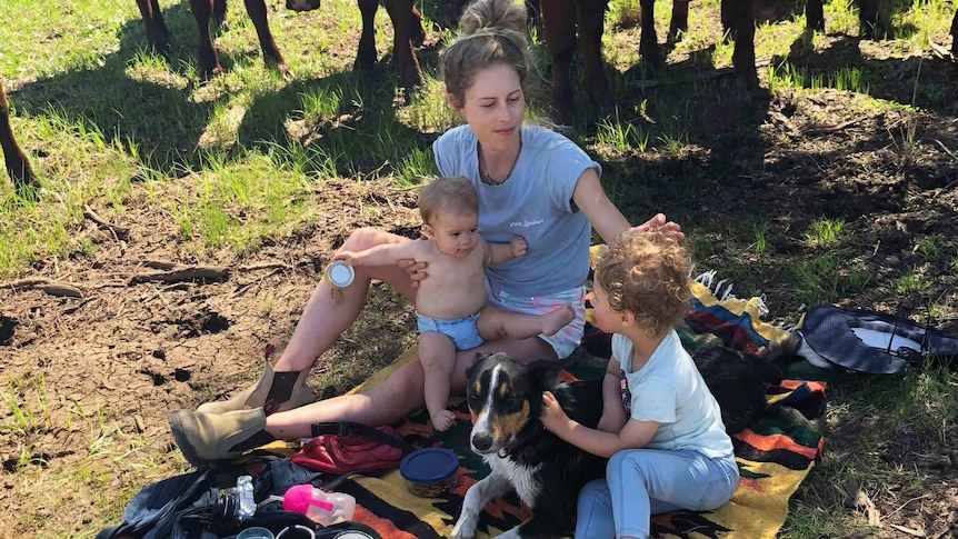 Virginia Tapscott have a picnic with her kids as cows watch on for a story about reducing household waste.