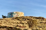 A painted water tank on a hill in Karratha.