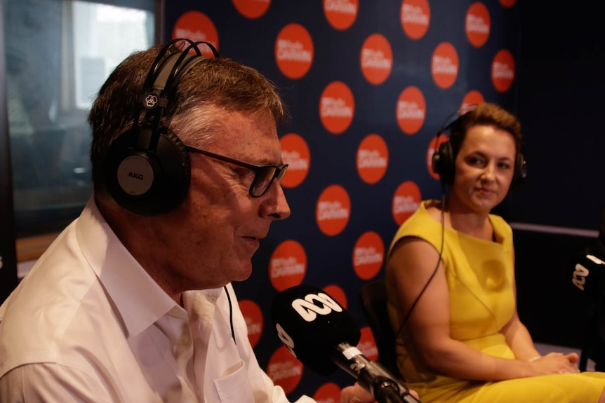 Territory Alliance leader Terry Mills speaks at a microphone inside the ABC Darwin radio room.