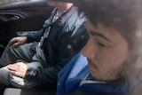 Sevdet Besim inside car being taken into court