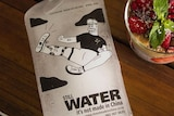 """A frozen bottle of water with the label """"It's not made in China""""."""