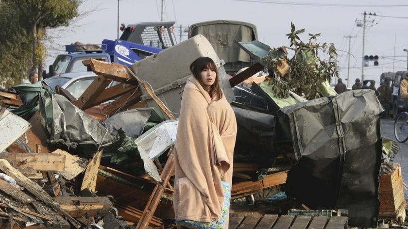 Stunned: A survivor in Ishimaki city, Miyagi prefecture.