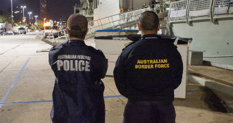 An Australian Federal Police officer and an Australian Border Force officer.
