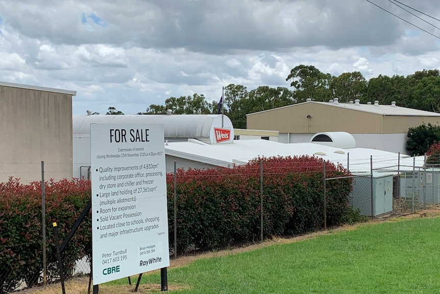 A for sale sign outside the Weis factory January 2021