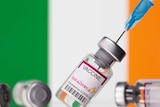 "Vials labelled ""Astra Zeneca COVID-19 Coronavirus Vaccine"" and a syringe are seen in front of a displayed Ireland flag"