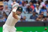 Australia batsman Shaun Marsh plays a powerful off drive during a Test against India at the MCG.
