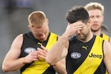 A group of Richmond AFL players walk off the MCG after losing to St Kilda.