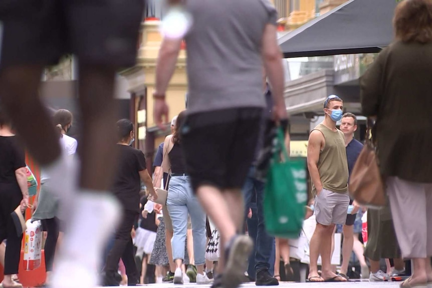 People walking with shopping bags in Adelaide.