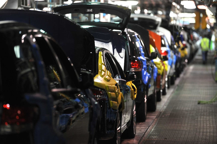 New cars on the assembly line at the Ford Manufacturing Plant in Broadmeadows.