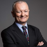 ABC election analyst Antony Green stands with his arms folded, smiling  in a profile photo