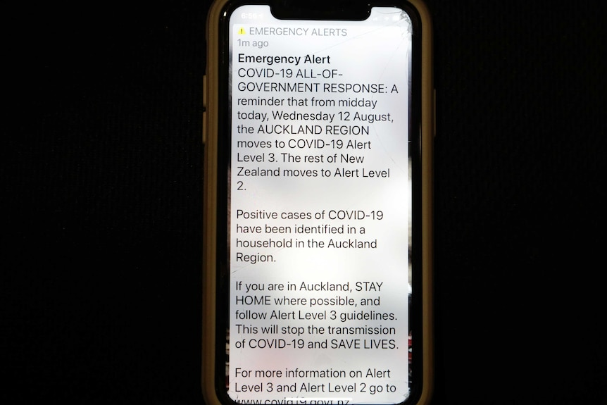 A news alert is displayed on a mobile phone in Christchurch, New Zealand