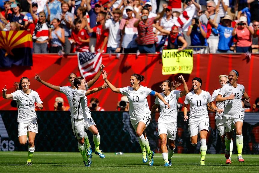 USA celebrates Carli Lloyd goal against Japan