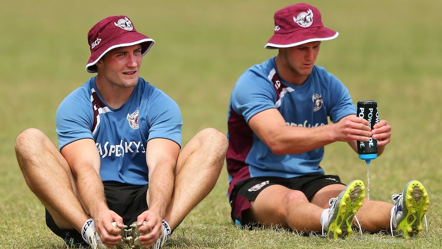 Foran, Cherry-Evans stretch at training