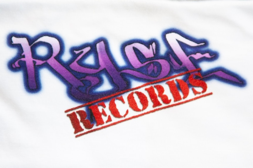 A purple and red logo reading Ryse Records