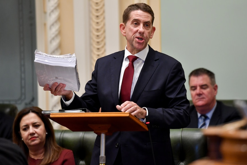 Cameron Dick holds budget papers.