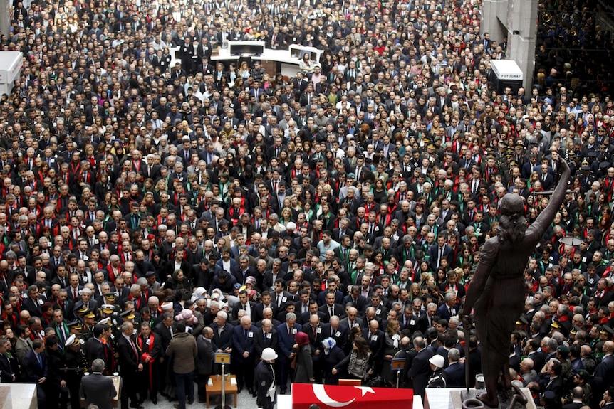 People attend the funeral ceremony of prosecutor Mehmet Selim Kiraz