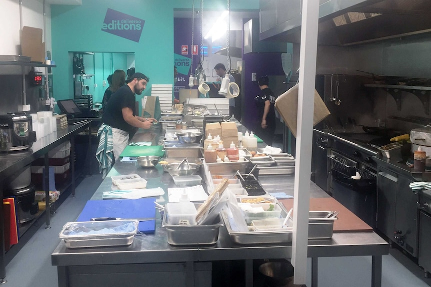 Chefs prepare food at a 'dark kitchen', which provides meals for delivery app Deliveroo.
