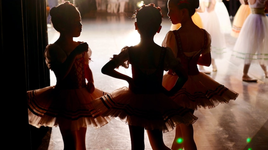 Girls in ballet outfits for story on children surviving in negative environments