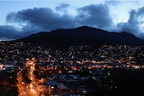 Hobart houses and streets under Mount Wellington at night