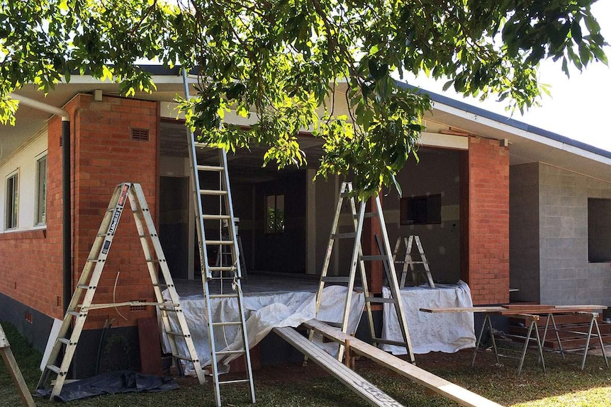 Renovation underway of a low-set red brick house at Edge Hill in Cairns.