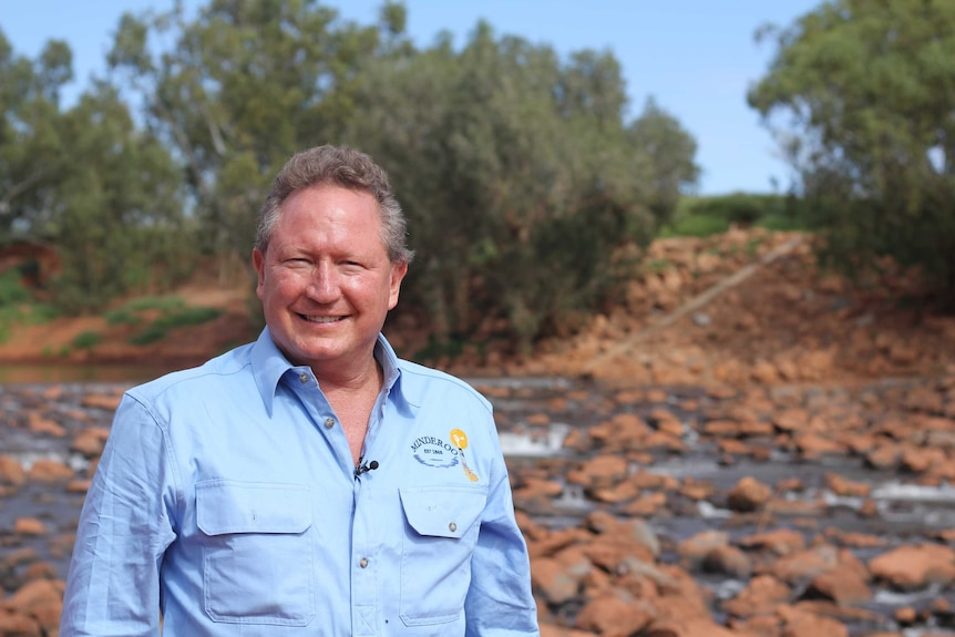 """Andrew """"Twiggy"""" Forrest stands in front of the upside-down weir he has developed beneath the Ashburton River on Minderoo"""