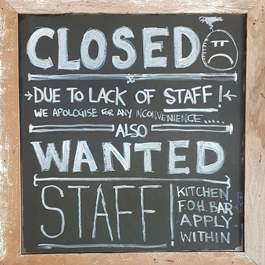 Sign on a blackboard searching for staff